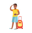 young man standing with suitcase and holding vector image vector image
