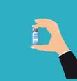 hand holding bottle coronavirus vaccine treatment vector image vector image