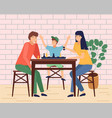 mother father son together at home playing table vector image vector image