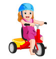 Very cute girl on tricycle vector image