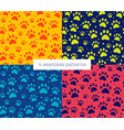 cat or dog paw set seamless patterns backgrounds vector image