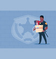 african american policeman fired hold box with vector image vector image
