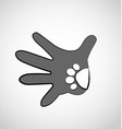 hand with dog paw icon vector image