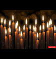 realistic burning wax candles with flame vector image vector image