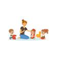 group of preschool kids and teacher sit on carpet vector image