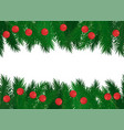 Red balls on green spruce branches frame
