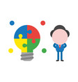 businessman character with puzzle light bulb vector image