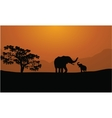 Silhouettes of elephants on mountain backgrounds vector image vector image
