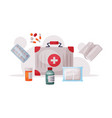 first aid kit box with medications emergency vector image vector image