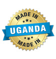 made in Uganda gold badge with blue ribbon vector image vector image