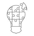 lightbulb in puzzle pieces icon vector image vector image