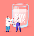 doctor in white lab coat advice woman drink soy vector image