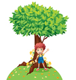 A young boy standing under a big tree vector image vector image