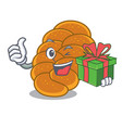 with gift challah mascot cartoon style vector image vector image