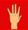 wedding golden ring on hand pop art vector image