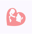 mother raising a baby in heart shaped silhouette vector image vector image