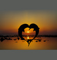two lovers dolphins in heart shape at sunset vector image vector image