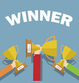 hands holding winners cups flat design vector image