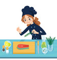 happy young cook preparing salmon steaks on vector image vector image