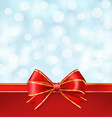 red bow with golden lines on blurry winter blue vector image vector image