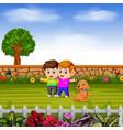 boys walk with their dog in garden vector image