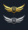 wings shield letter m logo template vector image vector image