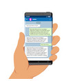hand holding smartphone with messenger app on its vector image