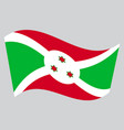 flag of burundi waving on gray background vector image vector image