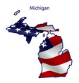 michigan full american flag waving in wind vector image vector image