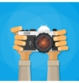 Hands holding photo camera vector image