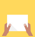 two dark-skinned hands holding white sheet vector image vector image
