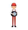 mechanic with tire avatar character vector image vector image