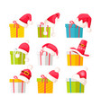 set of gift boxes with santa claus caps on white vector image vector image