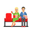 couple sitting in the cinema and watching 3d movie vector image vector image