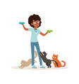 cute curly-haired girl feeding homeless cats vector image vector image