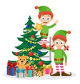 santa s helpers decorate the christmas tree on a vector image vector image