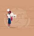 female african american chef cook holding octopus vector image vector image