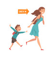 mother and her son running with their bags to vector image vector image