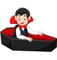 cartoon happy vampire in his coffin vector image vector image