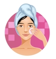 Woman with a towel cleaning her face with sponge vector image