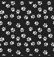 dog paw print dark seamless pattern vector image vector image
