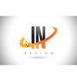 in i n letter logo with fire flames design and vector image