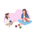 mother and daughter knitting socks mom teaching vector image