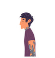 young brunette man with tattoos side view vector image vector image