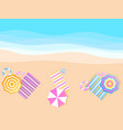 beach umbrella and towel on shore top view vector image vector image