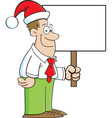 Cartoon Man Wearing a Santa Hat and Holding a Sign vector image vector image