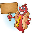 hot dog cartoon holding a blank wooden sign vector image vector image