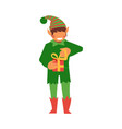 flat elf boy holding present box vector image vector image