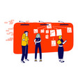 people sticking papers on big organizer workwall vector image