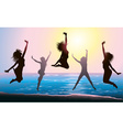 Silhouettes of Girls Jumping on the Beach vector image